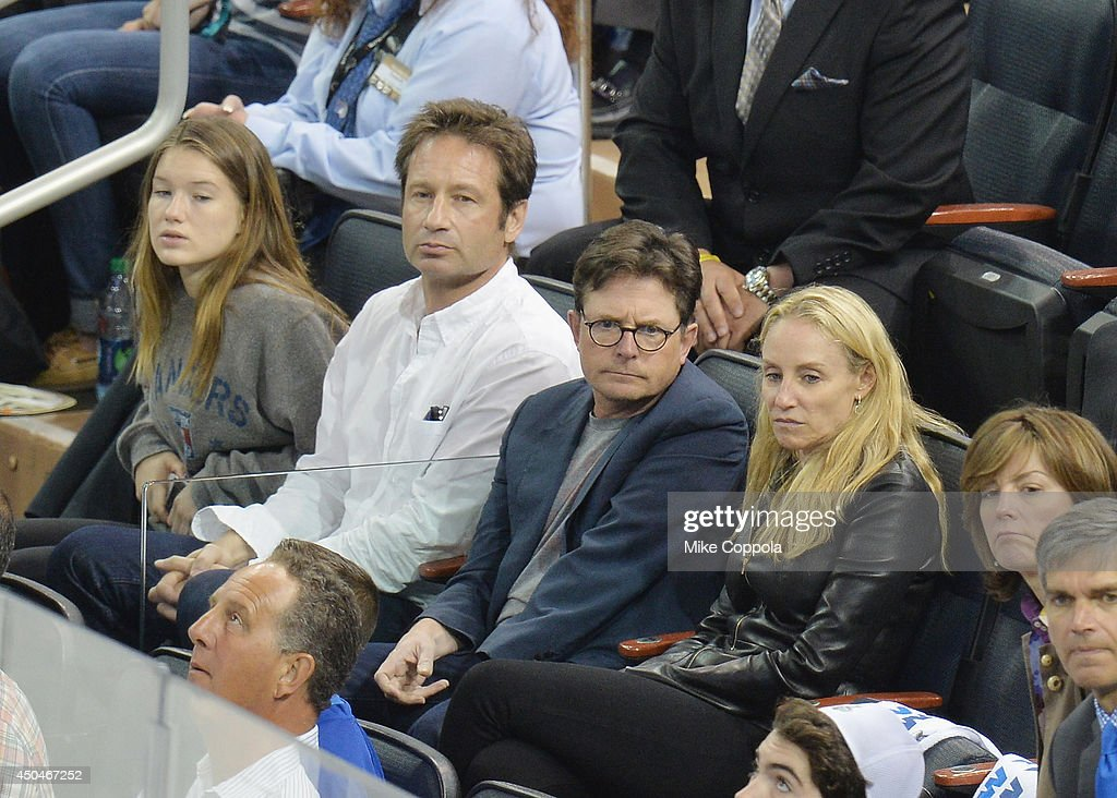 Madelaine West Duchovny, actor <a gi-track='captionPersonalityLinkClicked' href=/galleries/search?phrase=David+Duchovny&family=editorial&specificpeople=201628 ng-click='$event.stopPropagation()'>David Duchovny</a>, actress <a gi-track='captionPersonalityLinkClicked' href=/galleries/search?phrase=Tracy+Pollan&family=editorial&specificpeople=216511 ng-click='$event.stopPropagation()'>Tracy Pollan</a> and actor <a gi-track='captionPersonalityLinkClicked' href=/galleries/search?phrase=Michael+J.+Fox&family=editorial&specificpeople=208846 ng-click='$event.stopPropagation()'>Michael J. Fox</a> attend game four of the 2014 NHL Stanley Cup Final at Madison Square Garden on June 11, 2014 in New York City.