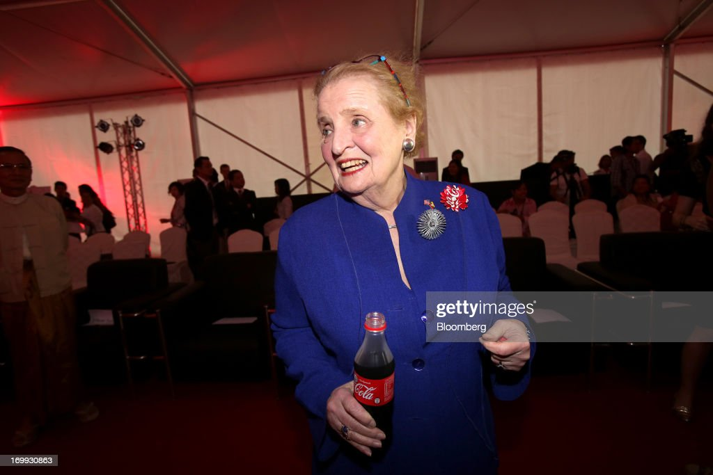 Madeleine Albright, former U.S. secretary of state, holds a bottle of Coca-Cola soda at the opening of the Coca-Cola Co. bottling plant in Hmawbi, Myanmar, on Tuesday, June 4, 2013. Coca-Cola Co. Chief Executive Officer Muhtar Kent marked the return of the world's largest soda maker to Myanmar after 60 years by opening a bottling plant and pledging more investment in the newly opened economy. Photographer: Dario Pignatelli/Bloomberg via Getty Images