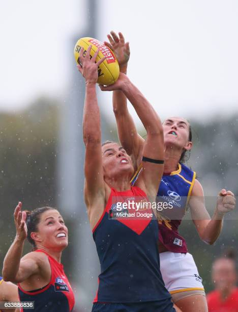 Madeleine Boyd of the Demons and Sharni Webb of the Lions compete for the ball during the round one Women's AFL match between the Melbourne Demons...