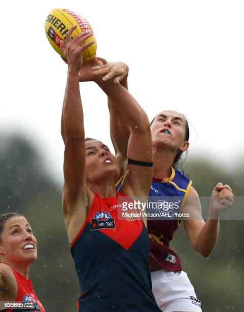 Madeleine Boyd of the Demons and Sharni Webb of the Lions compete in a ruck contest during the 2017 AFLW Round 01 match between the Melbourne Demons...