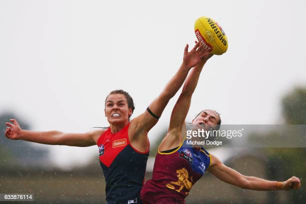 Madeleine Boyd of the Demons and Sharni Webb of the Lionscompete for the ball during the round one Women's AFL match between the Melbourne Demons and...