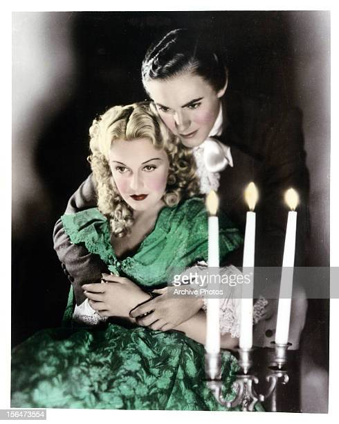 Madeleine Carroll is held by Tyrone Power in publicity portrait for the film 'Lloyd's Of London' 1936