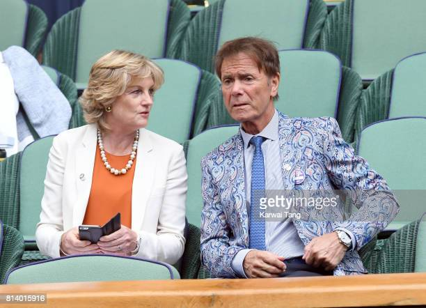 Madeleine Gurdon and Cliff Richard attend day ten of the Wimbledon Tennis Championships at the All England Lawn Tennis and Croquet Club on July 13...