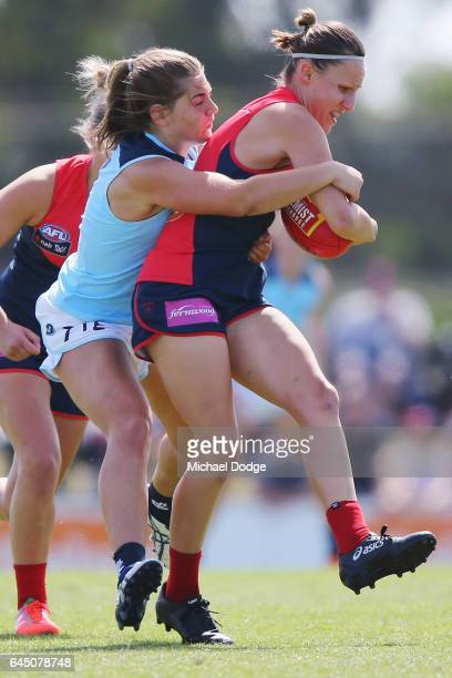 Madeleine Keryk of the Blues tackles Karen Paxman of the Demons during the round four Women's AFL match between the Melbourne Demons and the Carlton...