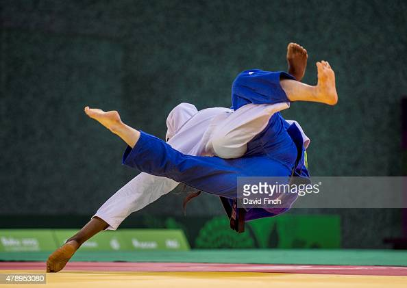 Madeleine Malonga of France throws Luise Malzahn of Germany for ippon to finish their women's team final 4 wins to one during the 2015 Baku European...