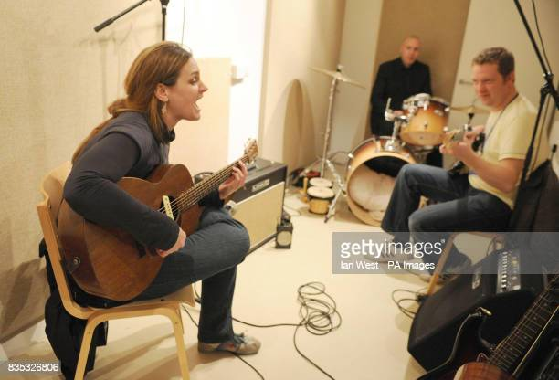 Madeleine Peyroux is seen performing with Richard Hellis and Matt Catlow as she visits homeless charity St Mungo's brand new recording studio The...