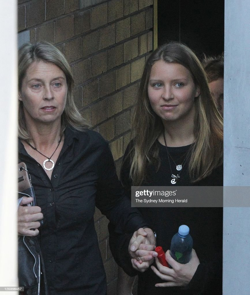<a gi-track='captionPersonalityLinkClicked' href=/galleries/search?phrase=Madeleine+Pulver&family=editorial&specificpeople=8015075 ng-click='$event.stopPropagation()'>Madeleine Pulver</a> emerges from her home with her mother on August 5, 2011 in Sydney, Australia. <a gi-track='captionPersonalityLinkClicked' href=/galleries/search?phrase=Madeleine+Pulver&family=editorial&specificpeople=8015075 ng-click='$event.stopPropagation()'>Madeleine Pulver</a>, aged 18, was the victim of a elaborate bomb hoax when a balaclava-clad man burst into her home in the wealthy Sydney suburb of Mosman, and chained a box with wires and a letter to her neck on August 3. For ten hours police and bomb squads were on site before safely removing the device from Pulver's neck. Police are still investigating the incident, treating it as an attempted extortion.