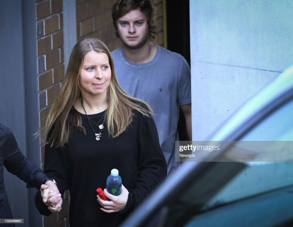 Madeleine Pulver leaves her home in Burrawong Avenue with family members the day after was attacked in her home on August 5, 2011 in Sydney, Australia. Madeleine Pulver, 18, was the victim of a elaborate bomb hoax when a balaclava-clad man burst into her home in the wealthy Sydney suburb of Mosman, and chained a box with wires and a letter to her neck on August 3. Police and bomb squads were on site for ten hours before safely removing the non-explosive device from Pulver's neck. Police are still investigating the incident, treating it as an attempted extortion.