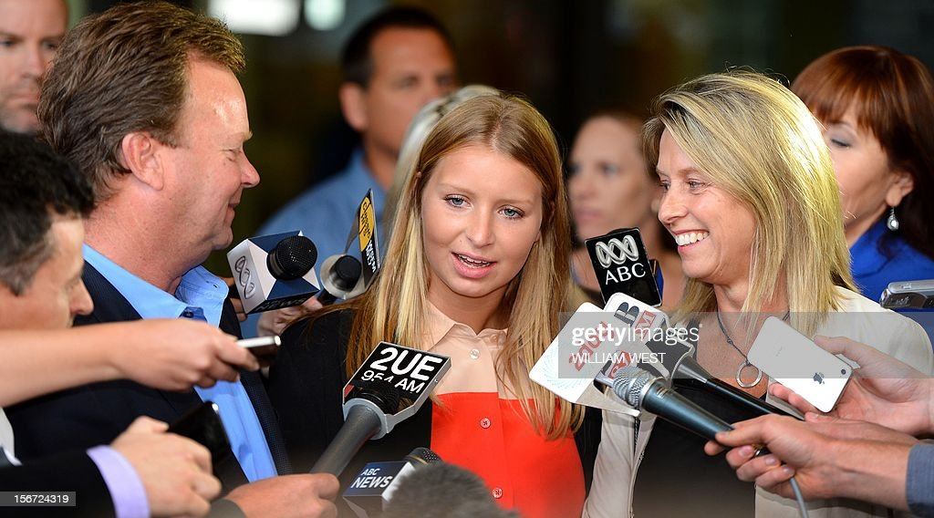 Madeleine Pulver (C) speaks to the media as her father Bill (L) and mother Belinda (R) listen in Sydney on November 20, 2012. An investment banker who attached a fake bomb around the neck of Pulver, a Sydney schoolgirl, in a bid to extort money from her wealthy family was jailed for at least 10 years. Paul Peters, who was arrested and extradited from the United States in September last year with the help of the FBI, pleaded guilty earlier this year to aggravated breaking and entering and detaining the teenager for advantage. AFP PHOTO/William WEST