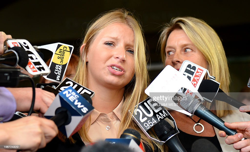 Madeleine Pulver (C) speaks to the media as her mother Belinda (R) listens outside of the court in Sydney on November 20, 2012. An investment banker who attached a fake bomb around the neck of Pulver, a Sydney schoolgirl, in a bid to extort money from her wealthy family was jailed for at least 10 years. Paul Peters, who was arrested and extradited from the United States in September last year with the help of the FBI, pleaded guilty earlier this year to aggravated breaking and entering and detaining the teenager for advantage. AFP PHOTO/William WEST