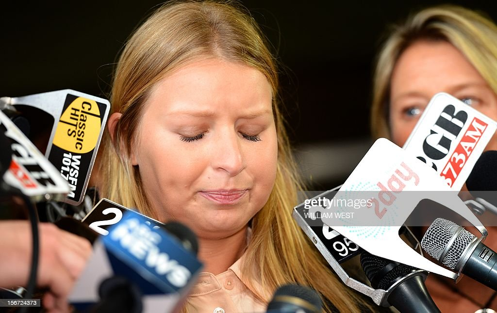 Madeleine Pulver (C) speaks to the media outside of the court in Sydney on November 20, 2012. An investment banker who attached a fake bomb around the neck of Pulver, a Sydney schoolgirl, in a bid to extort money from her wealthy family was jailed for at least 10 years. Paul Peters, who was arrested and extradited from the United States in September last year with the help of the FBI, pleaded guilty earlier this year to aggravated breaking and entering and detaining the teenager for advantage. AFP PHOTO/William WEST