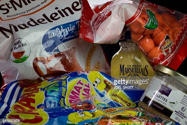Madeleine shellshaped cookies Carambar chewy candies strawberry Tagada candies traditional Petit Marseillais soap and rillettes are pictured on June...