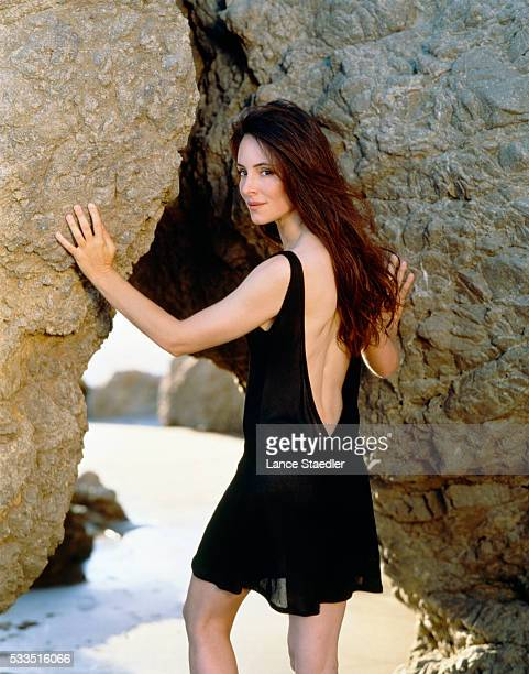 Madeleine Stowe by Beach Rocks