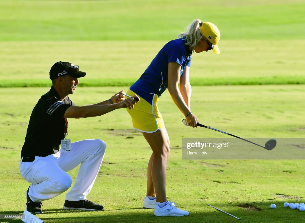 Madelene Sagstrom of Team Europe gets instuction from her coach on the range during practice for the Solheim Cup at the Des Moines Golf and Country Club on August 17, 2017 in West Des Moines, Iowa.