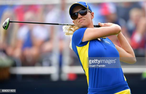 Madelene Sagstrom of Team Europe plays a shot during the final day singles matches of The Solheim Cup at Des Moines Golf and Country Club on August...
