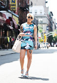 Madeline Dawson is seen around the Lower East Side wearing a Black Milk Clothing Company top and skirt Zara shoes Aldo purse American Apparel...
