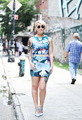 Madeline Dawson is seen around the Lower East Side wearing a Black Milk Clothing Company top and skirt Zara shoes American Apparel sunglasses...