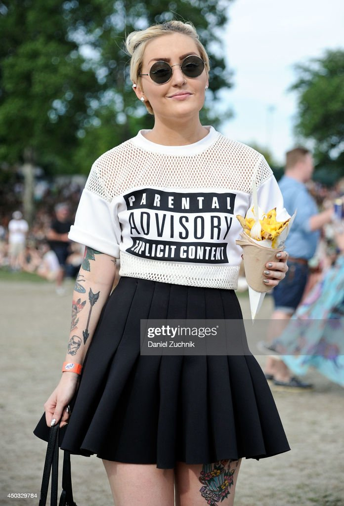 Madeline Dawson is seen wearing a Sheinside shirt HM skirt HM bag and American Apparel sunglasses during the 2014 Governors Ball Music Festival at...