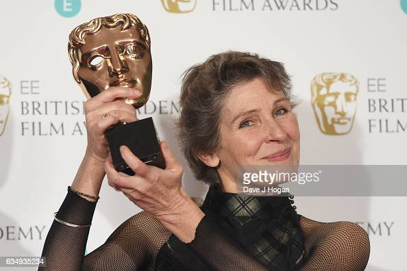 Madeline Fontaine poses with her award for Costume Design for the film 'Jackie' in the winners room at the 70th EE British Academy Film Awards at...