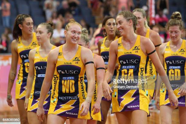 Madeline Mcauliffe of the Lightning and Cara Koenen smile after victory in the round three Super Netball match between the Thunderbirds and the...