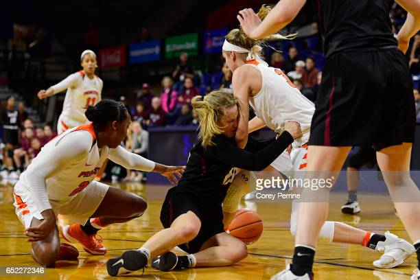 Madeline Raster of the Harvard Crimson runs into Bella Alarie as Sydney Jordan of the Princeton Tigers looks to corral the ball during the fourth...