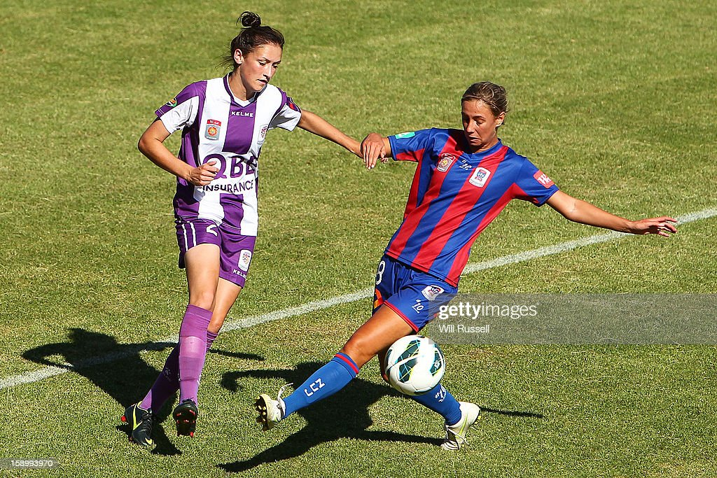 Madeline Searl of the Jets challenges for the ball during the round 11 W-League match between the Perth Glory and the Newcastle Jets at Intiga Stadium on January 5, 2013 in Perth, Australia.
