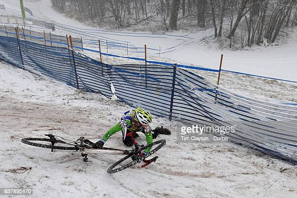 Madeline Smith from Colton New York slips on the snow and ice in the Women's Junior 1516 competition during the Cyclocross National Championships on...
