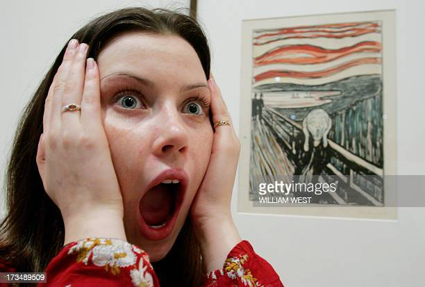 Madeline Wilson from the National Gallery of Victoria mimicks the scream from Edvard Munch's famous handcoloured lithograph version of 'The Scream'...