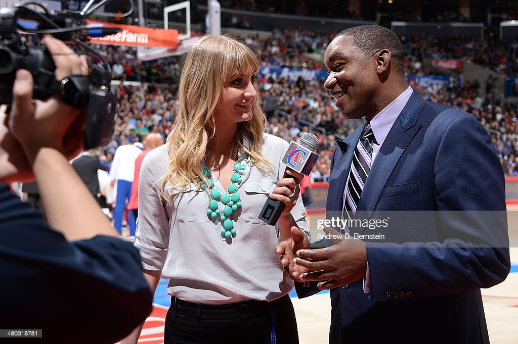 Madelyn Burke of LACTV interviews Isiah Thomas during a game between the Los Angeles Clippers and the Detroit Pistons at STAPLES Center on March 22, 2014 in Los Angeles, California.