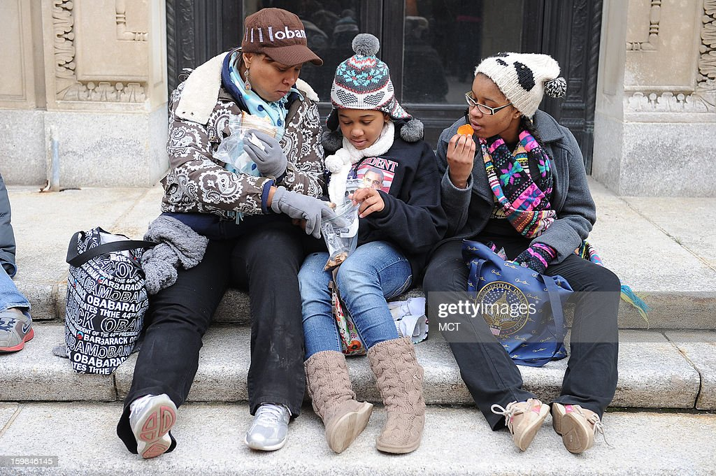 Madelyn McLemore of St. Louis, Missouri, eats lunch with her daughters Jesslyn, 10, and Jaie, 13, Randle after listening to President Barack Obama take the oath of office during his ceremonial swearing-in, Monday, January 21, 2013 in Washington, D.C.