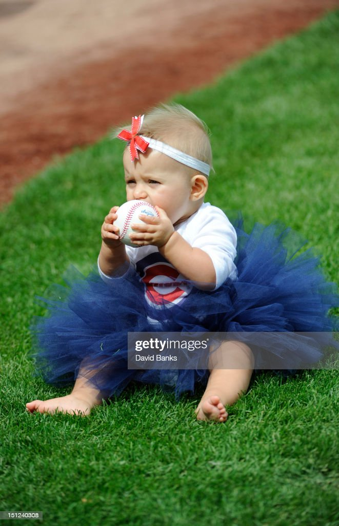 Madelyn Sharp waits as her father, Patrick Sharp of the Chicago Blackhawks, throws out the first pitch before the game between the Chicago Cubs and the San Francisco Giants on September 2, 2012 at Wrigley Field in Chicago, Illinois.