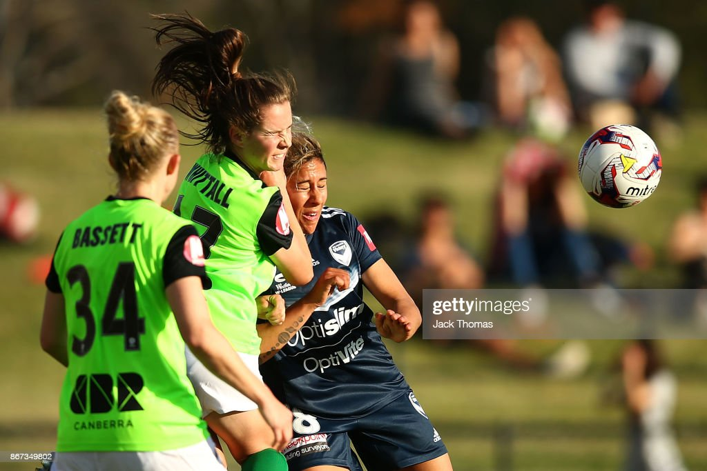 Madelyn Whittall of Canberra and Angela Beard of the Victory compete for the ball during the round one W-League match between Melbourne Victory and Canberra United at Epping Stadium on October 28, 2017 in Melbourne, Australia.