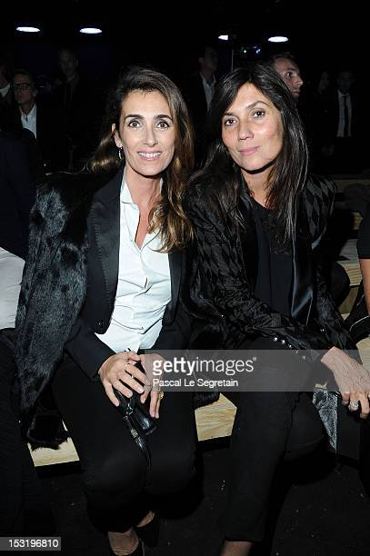 Mademoiselle Agnes and Emmanuelle Alt attend the Saint Laurent Spring / Summer 2013 show as part of Paris Fashion Week on October 1 2012 in Paris...