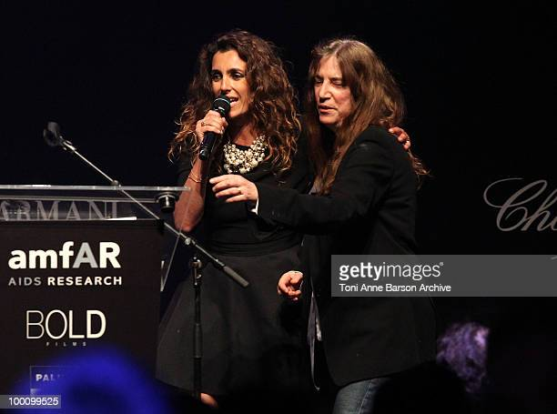 Mademoiselle Agnes and Patti Smith speak during amfAR's Cinema Against AIDS 2010 benefit gala at the Hotel du Cap on May 20 2010 in Antibes France