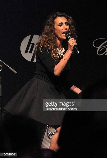 Mademoiselle Agnes speaks during amfAR's Cinema Against AIDS 2010 benefit gala at the Hotel du Cap on May 20 2010 in Antibes France