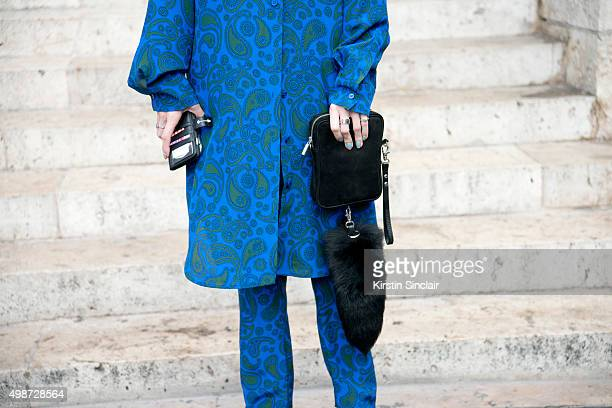 Mademoiselle Yulia wears a Stella McCartney top trousers sunglasses from a market and a Phenomena bag on day 7 during Paris Fashion Week...
