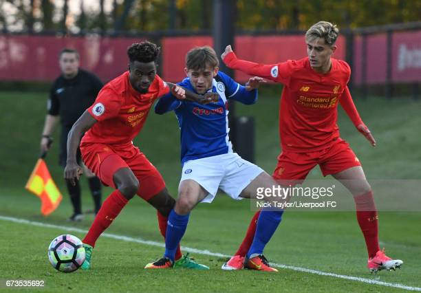 Madger Gomes and Yan Dhanda of Liverpool and Jack Stewart of Rochdale in action during the Liverpool v Rochdale Lancashire Senior Cup SemiFinal at...