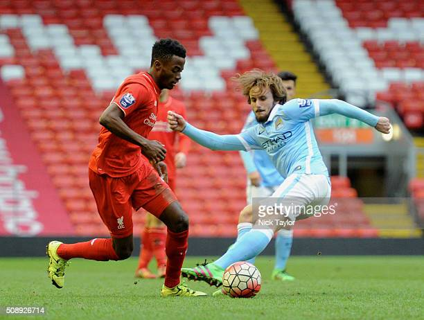 Madger Gomes of Liverpool and Aleix Garcia of Manchester City in action during the Liverpool v Manchester City Barclays U21 Premier League game at...