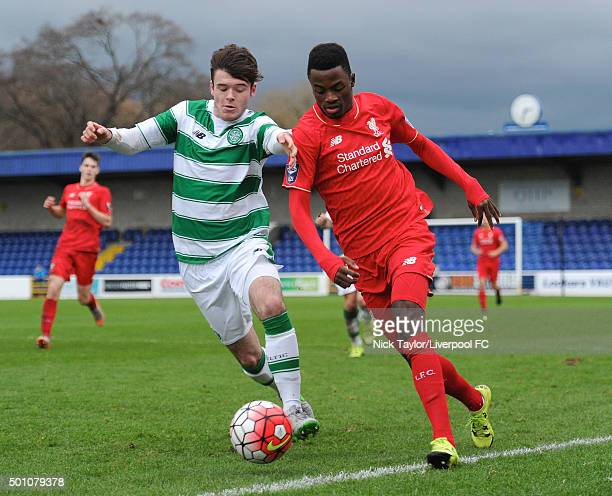 Madger Gomes of Liverpool and Dan Higgins of Celtic in action during the Liverpool v Celtic Premier League U21 International Cup game at the Lookers...