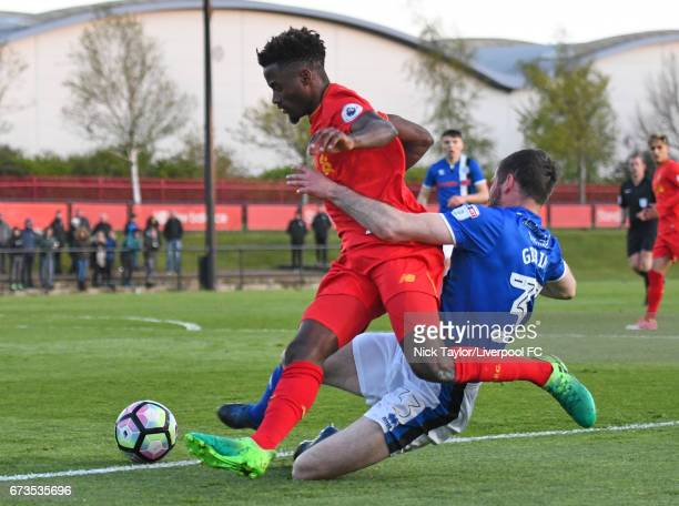 Madger Gomes of Liverpool and Kevin Gibbons of Rochdale in action during the Liverpool v Rochdale Lancashire Senior Cup SemiFinal at The Kirkby...