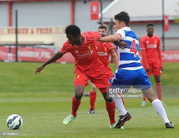 Madger Gomes of Liverpool and Lewis Collins of Reading in action during the U18 Premier League match between Liverpool and Reading at the Liverpool...