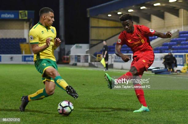 Madger Gomes of Liverpool and Louis Ramsay of Norwich City in action during the Liverpool v Norwich City U23 Premier League Cup game at Lookers...