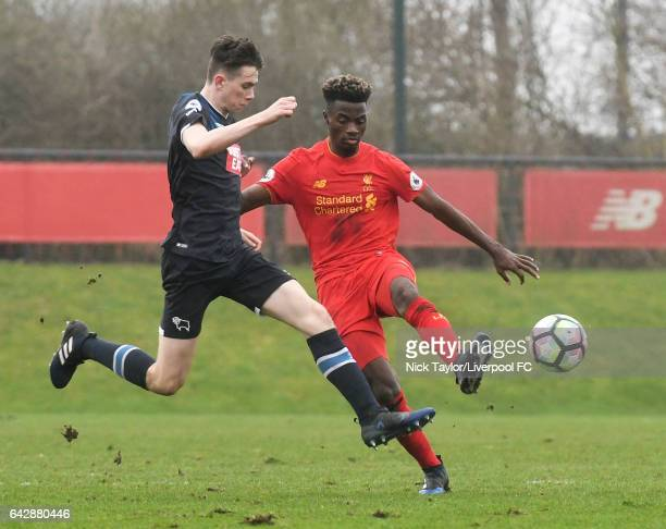 Madger Gomes of Liverpool and Max Bird of Derby County in action during the Liverpool v Drby County Premier League 2 game at The Academy on February...