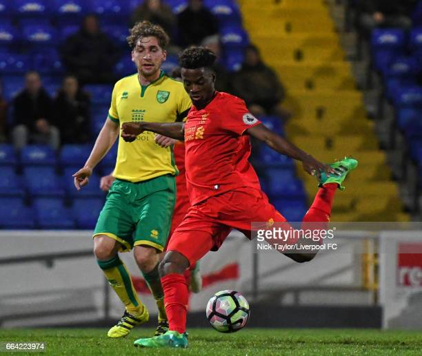 Madger Gomes of Liverpool and Raymond Grant of Norwich City in action during the Liverpool v Norwich City U23 Premier League Cup game at Lookers...