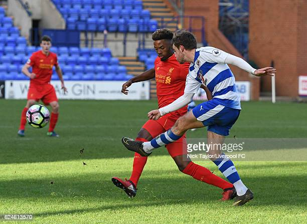 Madger Gomes of Liverpool and Tyler Frost of Reading in action during the Liverpool v Reading Premier League 2 game at Prenton Park on November 20...