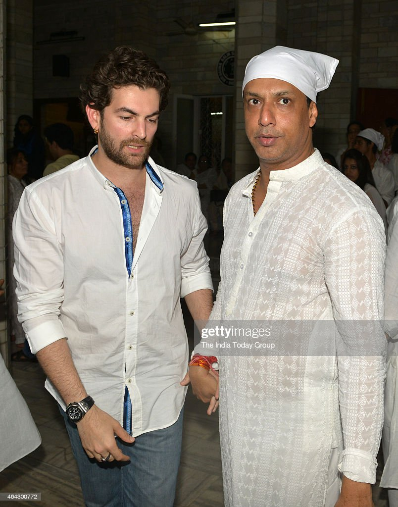 Madhur Bhandarkar with <a gi-track='captionPersonalityLinkClicked' href=/galleries/search?phrase=Neil+Nitin+Mukesh&family=editorial&specificpeople=5642805 ng-click='$event.stopPropagation()'>Neil Nitin Mukesh</a> at his mother's condolence meeting in Mumbai.