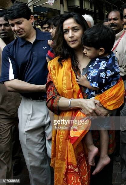 Madhuri Dixit comes out from Siddhivinayak Templewith her husband Shriram and two sons on Tuesday afternoon