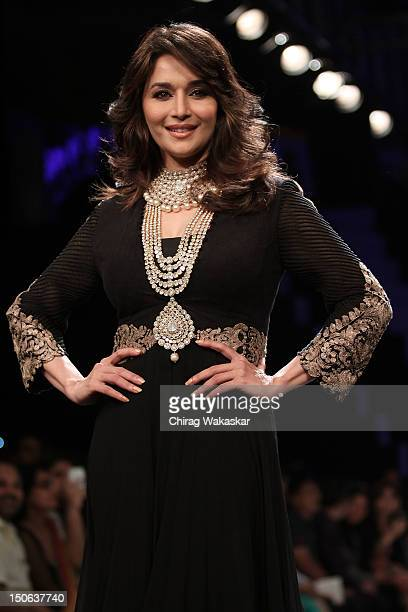 Madhuri Dixit walks the runway at the PCJ Grand Finale show of India International Jewellery Week 2012 day 5 at the Grand Hyatt on August 23 2012 in...