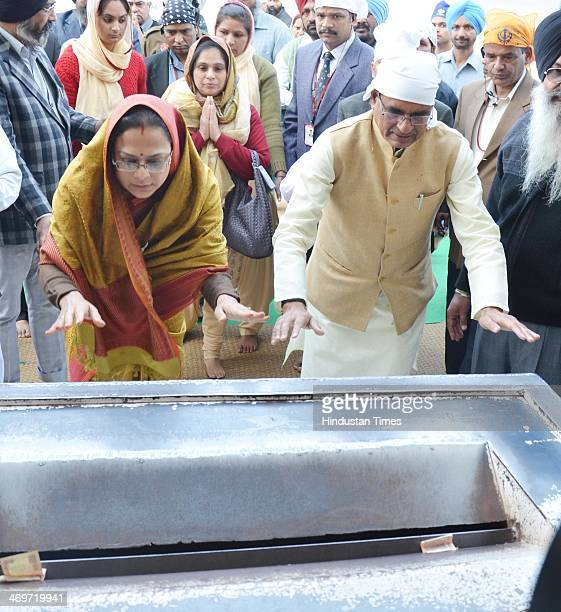 Madhya Pradesh Chief Minister Shivraj Singh Chauhan along with his wife Sadhna Singh pay obeisance at Golden Temple on February 16 2014 in Amritsar...