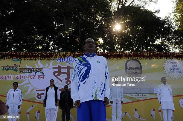 Madhya Pradesh Chief Minister Shivraj Singh Chouhan along with others taking part in mass Surya Namaskar on January 12 2017 in Bhopal India